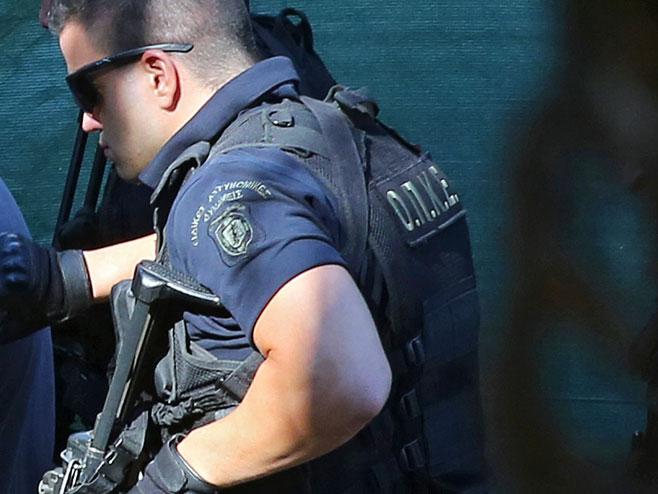 Грчка полиција (Фото: epa/Orestis Panagiotou) -