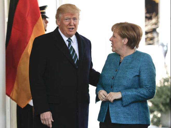 Доналд Трамп и Ангела Меркел (Фото: AP Photo/Pablo Martinez Monsivais) -